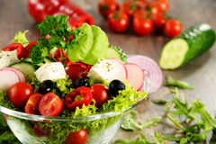 Vegetable salad bowl on kitchen table. Balanced diet Stock Photo