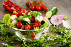 Vegetable salad bowl on kitchen table. Balanced diet Stock Photo