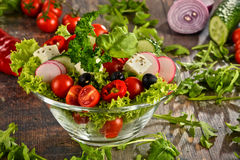 Vegetable salad bowl on kitchen table. Balanced diet Royalty Free Stock Photo