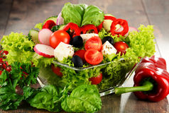 Vegetable salad bowl on kitchen table. Balanced diet Stock Images