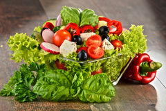 Vegetable salad bowl on kitchen table. Balanced diet Royalty Free Stock Photography