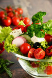 Vegetable salad bowl on kitchen table. Balanced diet Royalty Free Stock Photos