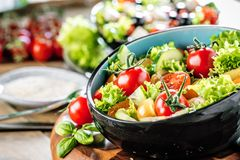 Vegetable salad bowl on kitchen table. Balanced diet. And healthy food stock photos