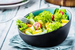 Fresh healthy salat bowl with tomates and cucumber stock photo