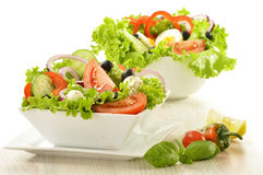 Vegetable salad bowl  on white Royalty Free Stock Images