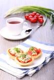 Vegetable salad and breakfast. Vegetable salad into tartlet, basket with salad Stock Image