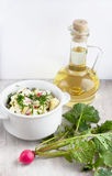 Vegetable salad of cabbage and radish, bottle with sunflower oil Royalty Free Stock Image