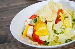 Vegetable salad with cheese, cabbage, pepper, tomato and cucumber Stock Photos