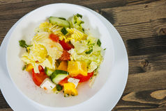 Vegetable salad with cheese, cabbage, pepper, tomato and cucumber Royalty Free Stock Image