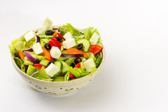 Vegetable salad with cheese, lettuce and olives. Salad with lettuce, olives, cheese, peppers, onion and cucumber Stock Images