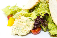 Vegetable salad and cheese. Salad vegetables and goat cheese on a white background Royalty Free Stock Photography