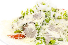Vegetable salad and cheese. Salad vegetables and goat cheese on a white background Stock Photos
