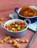 Vegetable Salad with chick-pea. A plate of salad with tomato and cucumbers chick-pea Stock Photo