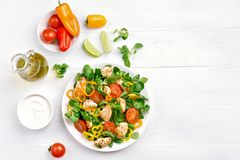 Vegetable salad with chicken meat. On white wooden background with copy space. Top view, flat lay Stock Images