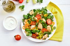 Vegetable salad with chicken meat. On white wooden table. Top view, flat lay Stock Images