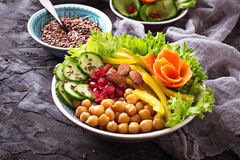 Vegetable salad with cucumber, pepper, almond and chick-pea in j Stock Image