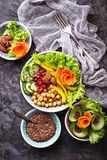 Vegetable salad with cucumber, pepper, almond and chick-pea in j Stock Photos