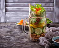 Vegetable salad with cucumber, pepper, almond and chick-pea in j Royalty Free Stock Photos
