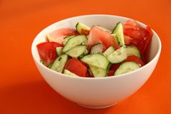 Vegetable salad of cucumbers and tomatoes. Tasty vegetable salad of cucumbers and tomatoes Stock Image
