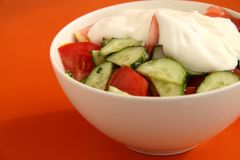 Vegetable salad of cucumbers and tomatoes. Tasty vegetable salad of cucumbers and tomatoes Stock Photography