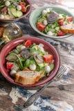 Vegetable salad. Delicious salad with avocado, cherry tomatoes, arugula and mozzarella cheese. Tasty and healthy food. Tasty and healthy food. Vegetable salad royalty free stock photos