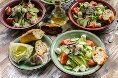 Vegetable salad. Delicious salad with avocado, cherry tomatoes, arugula and mozzarella cheese. Tasty and healthy food. Vegetable salad. Tasty and healthy food stock photos
