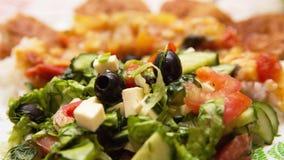 Vegetable salad on a dim background. Salad from vegetables on a dim background Royalty Free Stock Images