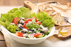 Vegetable salad with feta cheese, black olives and vinegar dip Royalty Free Stock Images