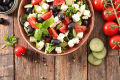 Vegetable salad with feta. Olive and tomato Royalty Free Stock Photo
