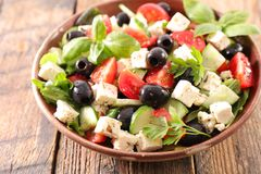 Vegetable salad with feta. Olive and tomato Stock Photography