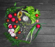 Vegetable salad food photo. Ingredients for the preparation of fresh vegetarian vegetable salad, vegetables radishes, cherry tomatoes, lettuce, green salad dill Royalty Free Stock Image