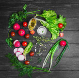 Vegetable salad food photo. Ingredients for the preparation of fresh vegetarian vegetable salad, vegetables radishes, cherry tomatoes, lettuce, green salad dill Stock Photos