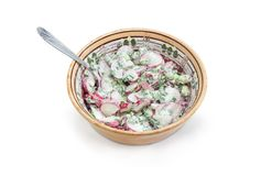 Vegetable salad of sliced red radish and chopped green onion Royalty Free Stock Photos
