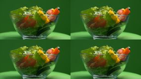 Vegetable salad in glass bowl rotating, vegetarian food, tasty appetizer, diet. Stock footage stock video footage