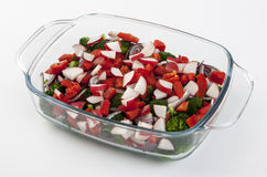 Vegetable salad in a glass dish on the white background Stock Image