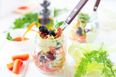 Vegetable salad in glass jar Stock Images