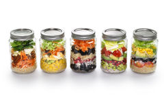 Vegetable salad in glass jar, white background stock photos