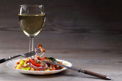 Vegetable salad and glass with wineglass. Vegetable salad and glass with wine Royalty Free Stock Photo