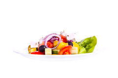 Vegetable salad, Greek salad. Greek salad on a plate. On a white background Stock Photography