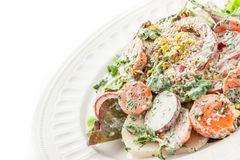 Vegetable salad with greens and sesame on the white background Royalty Free Stock Photography