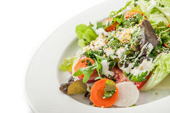 Vegetable salad with greens and sesame on the white plate Royalty Free Stock Photography