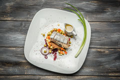 Vegetable salad with herring olive oil on wooden background stock images
