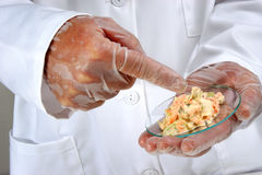 Vegetable salad is investigated Royalty Free Stock Image