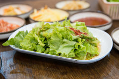 Vegetable salad korean stlye on the woon table Royalty Free Stock Photography