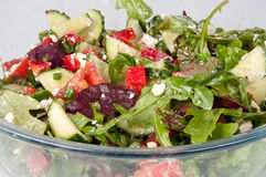 Vegetable salad in a large glass bowl. Vegetable salad in a glass bowl Stock Photo