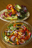 Vegetable Salad and Large Plate of Wasted Peelings Royalty Free Stock Photo