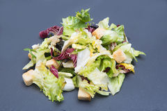 Vegetable salad with lettuce on black stone Stock Images