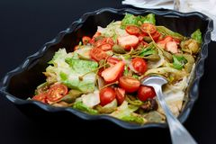 Vegetable salad made of tomatoes, lettuce leaves stock photos