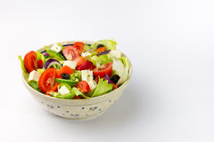 Vegetable salad. Made from tomatos, peppers, cheese, onion and lettuce, seasoned by thyme and olive oil Royalty Free Stock Photos