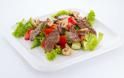 Vegetable salad with mashrooms and meat isolated Stock Photo